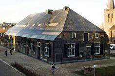 A glass house that has been photo-printed to look like a historical local farmhouse in Schijndel, a town in The Netherlands. By Dutch architectural firm MVRDV.    Featuring a façade made completely of glass, this unique, translucent building has an interesting mirage-like quality that may make you wonder if it is really there.