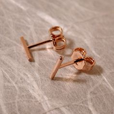 7mm x 1mm Solid 14k Rose Gold Bar Studs Small by SARANTOS on Etsy