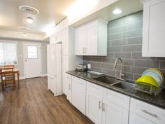 gray kitchen white cabinets with granite countertops | top