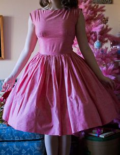 I love this pink dress against the pink christmas tree in the background