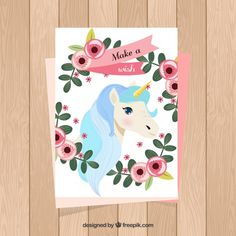 Cute card with unicorn and floral frame Free Vector