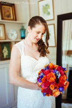 Beautiful bride, super saturated colorful bouquet Bridal bouquet by Karla Cassidy Designs www.karlacassidydesigns.com Image courtesy of Caroline Alden Photography www.carolinealdenphoto.com