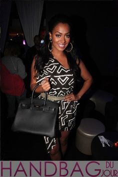 La-La-Anthony-attended-the-Bottles-and-Strikes-2-year-anniversary-at-Frames-in-New-York-City-carrying-a-black-Hermes-Birkin-bag