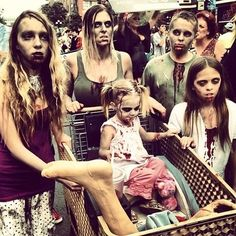 This happy zombie family just taking a trip to the grocery store. | 20 Badass Zombie Sightings At Comic-Con