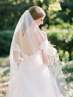 Off-the-shoulder lace wedding dress: http://www.stylemepretty.com/2016/12/06/hurricane-matthew-wedding-relocation/ Photography: Amy Arrington - http://www.amyarrington.com/