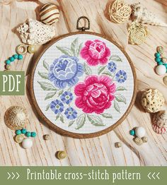 Pink Blue Flowers Cross Stitch Pattern This pattern is an instant download PDF. Size: 110w x 114h stitches 14 Count Aida: approx. 7.86 x 8.14 inches or 19.96 x 20.68 cm Stitches Required: Full cross stitches Colors Required: 8 DMC floss colors PDF Included: - Pattern in color symbols