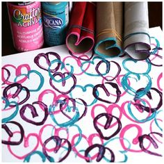 Stamping hearts with cardboard rolls and paint.  Such a fun way to create Valentines art or a custom piece of artwork for a child's bedroom! - Happy Hooligans