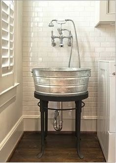 Ahhh! galvanized tub. Love for a utility sink in laundry room or outdoor kitchen.