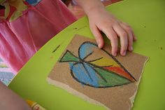 Crayons on sandpaper. It's vibrant and it sharpens your crayons at the same time!