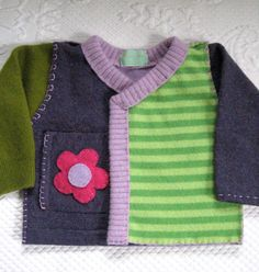Baby and children clothing, made out of soft recycled wool sweaters. The sweaters are boiled (felted), cut apart and then reassembled. Each sweater