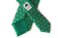 """SHIPS AHOY - """"Seas"""" the day with this dark olive nautical tie sailing across your chest. Escaping to the far and away on your next journey, the tan sailboats will give your suit a sense of adventure"""