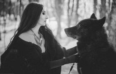 Beautiful black and white of a witch and her familiar.