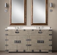 RH's Heirloom Silver-Chest Double Vanity:In the days of heirloom silver, families stored their prized flatware and serving pieces in heavyweight wooden trunks fitted with interior organization. Inspired by the aesthetic and impressed by the practical utility of the trunk, we've repurposed it, in materials suitable for the bath.