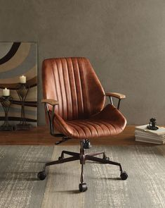 Add an edgy industrial style to your home office with the Hamilton Office Chair by Acme Furniture. This swivel and adjustable chair have leather upholstery with cushioned long stitched stripes on the seat and back. The five-star base with casters and meta