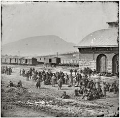 """1864. """"Chattanooga, Tenn. Confederate prisoners at railroad depot waiting to be sent north."""""""