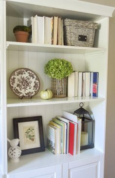 I shared a few pictures of these bookshelves in my house tour post on Monday, and I know I've shown these 50 zillion times, but I did ch...