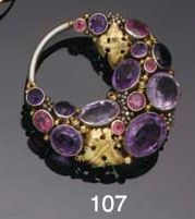 Sibyl Dunlop (attrib., but I am sure it is by Dorrie Nossiter). An Arts and Crafts gem brooch. An Arts and Crafts brooch designed as a stylised vine of collet-set amethysts and pink tourmalines with leaf decoration, on a hoop mount.