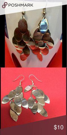 ♦️reflective silver tear drop shaped leaf earrings Silver earrings drop style made up of layers of  small tear drop shaped leaves. Jewelry Earrings