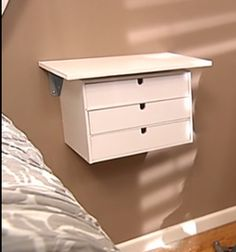 DIY Floating nightstand - i wonder how long this would last before the boys tried using it as some sort of launch pad.