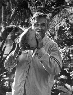 "CARY GRANT, Holding a coconut on the set of ""Father Goose,"" 1963"