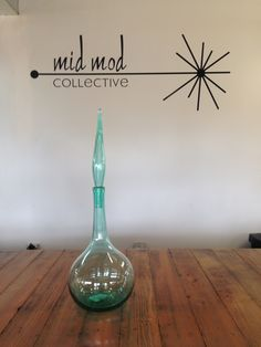 Vintage modern hand blown glass decanter. Available at Mid Mod Collective. Email midmodcollective@gmail.com for more info. SOLD!