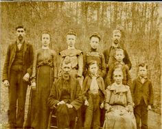 left to right back row: Doc Waddel, Caroline (they called her 'Line'), Helen (they called her 'Healin') Martha, Wad Mize left to right front row: John Crawford Mize, Sarah Mink Mize, Young boys on either side of Sara h: Ed & Fred Mize (twins), Tall boy behind Sarah is Millard Mize