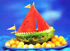 """Beach Party Watermelon Boat on a """"sea"""" of cantaloupe balls! Party Fruit Platter, Watermelon Boat, Crudite, Fruit And Vegetable Carving, Food Carving, Summer Snacks, Edible Food, How To Eat Better, Fruit Art"""