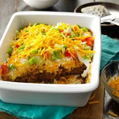 Potluck Taco Casserole Recipe -This is the dish I take most often to potlucks, and the pan comes home empty every time. It has the irresistible taco taste that everybody craves. —Kim Stoller, Smithville, Ohio