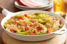 Here's a family favorite just waiting to be discovered: a glorious 30-minute chicken and rice skillet with cheddar, peppers and tomatoes.
