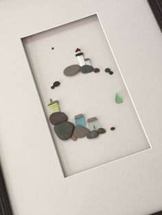 A personal favorite from my Etsy shop https://www.etsy.com/ca/listing/453980734/12-by-16-sea-side-art-made-with-pebbles