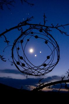 Venus, Jupiter, and the Moon in December 2008. Sally J. Smith makes environmental sculptures in the Adirondack Mountains and captured this amazing photograph.