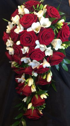 Red rose and freesia shower bouquet in Christmas colours winter wedding