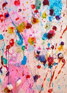 cotton balls with paint and throw on to paper