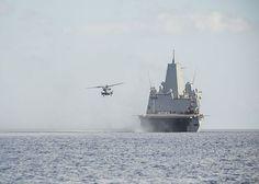 An CH-53E Super Stallion, attached to Marine Medium Tiltrotor Squadron (VMM) 365, departs the flight deck of the amphibious transport dock ship USS Mesa Verde (LPD 19).