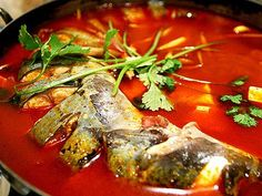A special food called Fish in sour soup,you should taste the delicious food by youself.