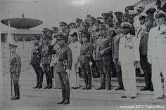 Victory Monument Dedication 1941 with Field Marshal Phibun Songkhram taking the salute in front of Thai, Japanese, German and Italian dignatories . The Field Marshal's wife  La Iad is the lady in military uniform.