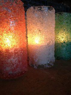 Mix food coloring with Epson salt & glue to outside of vase/votive /jar,tea light inside. Centerpiece with snow miser.