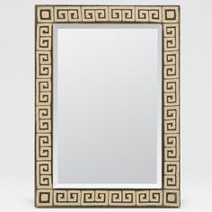 Erastos Mirror - The Erastos mirror by Made Goods invokes images of ancient Grecian temples built to honor the gods. Its mesmerizing Greek Key pattern, created by hand beading warmed aged velvet, dramatically fills the profile. This exotic piece turns any room into a temple worthy of its master. $1,200