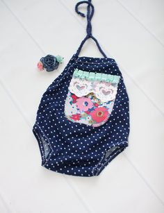 Doting Over Dots - newborn halter romper in navy blue and white polka dots with…