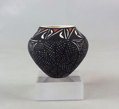 "Standing only 1 1/4"" tall and 1 1/2"" diameter, this sweet little Acoma jar has the exact shape of a full size olla."