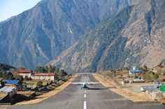 Lukla Airport in Nepal: just 527 meters of Runway on a downwards hill with a 12 percent angle and a  600 meter deep cliff at the end where the Himalaja river Dudhkoshi runs