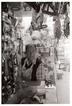 Mr Derek Johns, saddler, in his shop.   Buttgarden Street, Bideford, July 1983. Photograph by James Ravilious © Beaford Arts