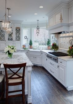 Kitchen with Granite countertops, white cabinets. So light and cheery!