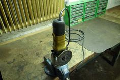 Bracket to turn an angle grinder into a really  portable and stowable bench grinder.