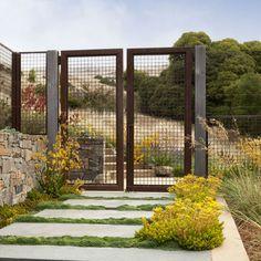 Front Door Area: Large Concrete slabs with Grass/groundcover inbetween