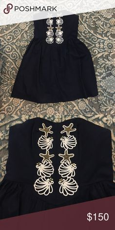 Lilly Pulitzer dress Worn twice, navy blue with sea shell detailing. Will negotiate on price. Lilly Pulitzer Dresses Strapless