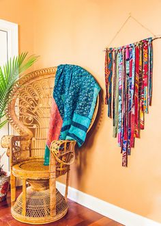 A wonderland of vibrant colors and vintage fabrics, this fun extra large wall hanging brings whimsy and delight into any room. Perfect to hang over a bed