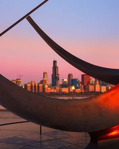 5 Best Places to See the Chicago Sunrise like here at the Alder Planetarium, looking at the Chicago skyline through the Man Enters the Cosmos cast bronze sculpture by Henry Moore located on the Lake Michigan lakefront outside the Adler Planetarium! Chicago Photography, Chicago Skyline, Henry Moore, Lake Michigan, Bronze Sculpture, Cosmos, Places To See, The Outsiders, Sunrise