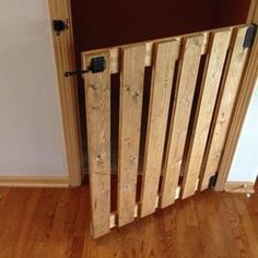 by wooden baby gate. Made from common boards, sanded it down, stained it Golden Oak, screwed it together with wood screws, used a gate latch also. Wood Baby Gate, Diy Dog Gate, Diy Gate, Baby Gate For Stairs, Diy Baby Gate, Stair Gate, Baby Gates, Basement Furniture, Diy Pallet Furniture