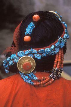 TURQUOISE, CORAL & GOLD decorate this TIBETAN WOMAN'S hair - LHASA, TIBET